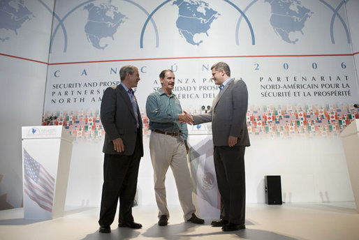 President George W. Bush, Mexico's President Vicente Fox, center, and Canadian Prime Minister Stephen Harper, right, meet to shake hands following their joint news conference, Friday, March 31, 2006 in Cancun, Mexico, at the conclusion of their summit meeting. White House photo by Eric Draper